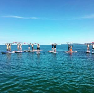 Corsi individuali o di gruppo allo Spot 1 Surf School Center